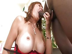 Busty mom Desi Foxx gets it from a big black schlong