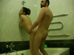 Bearded man washes his sexy girlfriend in bathroom, soaping her sweet hole and then undresses to fuck her right there.