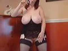 Plump lady with extremely big round boobs spreads her legs in stockings and pushes her small plastic toy into her cunny.