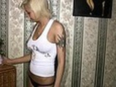Sassy tattooed blond always inspires her boy-friend to make hawt new home movies with her starring in them. This time she oiled her smooth firm body and sticking tits in front of him then admiring herself in the mirror!