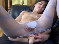 Nasty girlie in blue spiral pattern hose stuffing her itchy slit hole