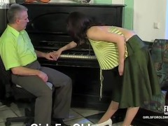 Breasty gal in a provoking blouse getting it on with her grey-haired teacher