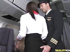 Willing for take-off captain! But in advance of that, this curvy flight stewardess went down on her knees to give the pilot a blowjob! Joining the mile-high club has never been this hot, especially when a beautiful brunette hair cabin crew strips for the captain to caress her large ass! Bon voyage passengers!