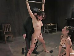 Vai is a hot brown haired milf who enjoys having electrodes all over her body during the time that she is tied up with bondage devices. She too has a ball gag in her mouth, because they know she is a screamer. She has a large time pleasure when Princess Donna Dolore takes a vibrator and begins rubbing on that shaved pussy.