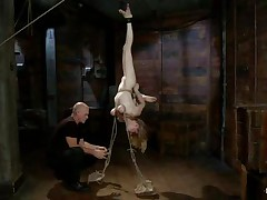 He has tied her upside down and makes her naked by tearing her clothes with scissors. Spanked her shaved pussy after removing her panties and then tied her beautiful boobs with ropes. She was desperate to get his hard cock in her mouth and he gave it in her mouth for blowjob. Her boobs and pussy were spanked as she was performing blowjob.