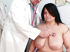 Obese dark brown Rosana went to doctor's to receive her body checked up well. But there is this naughty pervert doctor who makes her naked and starts playing with her firm plump body! See how that guy is toying with her huge mangos and gaping her pussy. That guy even fingers it to make her horny so that that guy can screw her well!