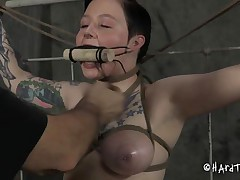 Doesn't she looks good tied in that position and mouth gagged? We don't want her screams disturbs the executor do we? She's a cutie and the way this guy tied and squeezed her boobs shows his experience. The guy then inserted a dildo attached at a stick that he tied with ropes, pretty ingenious!