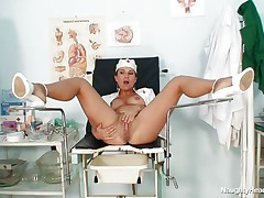 Kamila is a naughty nurse and she spreads those long sexy legs so that we can see her beautifull shaved cunt. Look at her as she inserts a dildo in her vagina and then a very interesting instrument. Those sexy spreaded legs on the medical table are asking for a huge load of cum on them, will she receive some?
