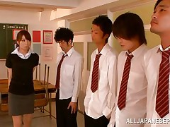 Arisu wants discipline and she aligns her students in order and then kneels to suck each and every one. The boys broke the line and surrounded her so now she has all those hard cocks around her pretty face. Can she handle all those dicks and will they repay their teacher with a few loads of cum on her face?