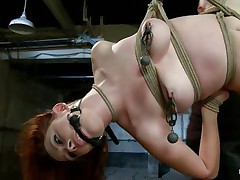 As she hangs there tied up and with her sexy legs spread wide, this cutie gets her pussy fingered and whipped by this bald old guy. He eats her young cunt with pleasure and takes his time punishing her. The girl is hot, her hair is red her skin is milky white and that cunt between her sexy legs is just begging for cum.
