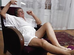 See this short haired granny masturbating in her room. She is alone and she needs to calm the bitch inside her who needs cocks to fuck. So this lady has only one way to survive. That is playing on her own! See how she is groping her own tits and then rubbing her pussy before doing a nice fingering!