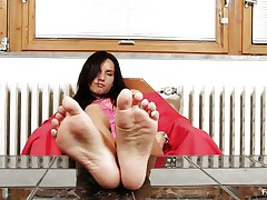 Sharon loves sucking, most especially her toes. Watch this hot brunette with long dark hair and slutty face as she sucks her sexy feet and shows us what she is capable of, do you think that she would suck them with even more pleasure if she had some semen on them?