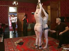 On the Upper Floor, cuties all over the place are being punished. There's two tied up face to face getting caned, another being flogged while holding a stripper pole, another getting spanked by a man and her face slapped by a woman, another getting her ass lashed with a whip, and one sucking cock.