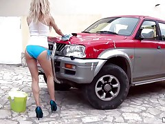 Sexy Michelle Moist is at outdoor washing a car. And she is all wet due to this washing stuff. Well, wet means she is wet in her c section too. Getting crazy with her temptation she is taking off her clothes and showing her small tits and tight ass. And that attracts a dick which she is sucking now.