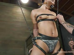 What do we have here? It's a slut, all tied up in leather strap and hangs there waiting to be punished. She was a very bad girl and her punishment needs to be hard! Wenona has her mouth gagged and the executor rubs her muff with a vibrator. Let's watch if that guy has something to stick it in her wazoo