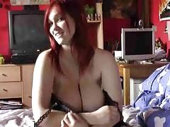 Breasty Redhead masturbates