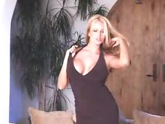 Breasty pornstar in black dress striptease